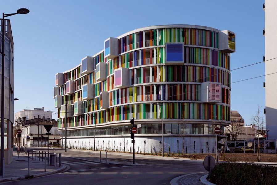 Colorful facade Arc en Ciel building designed by Barnard Buhler Architects