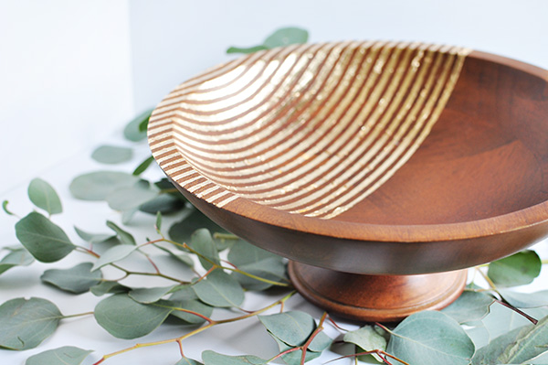 Striped wood bowl with gold foil