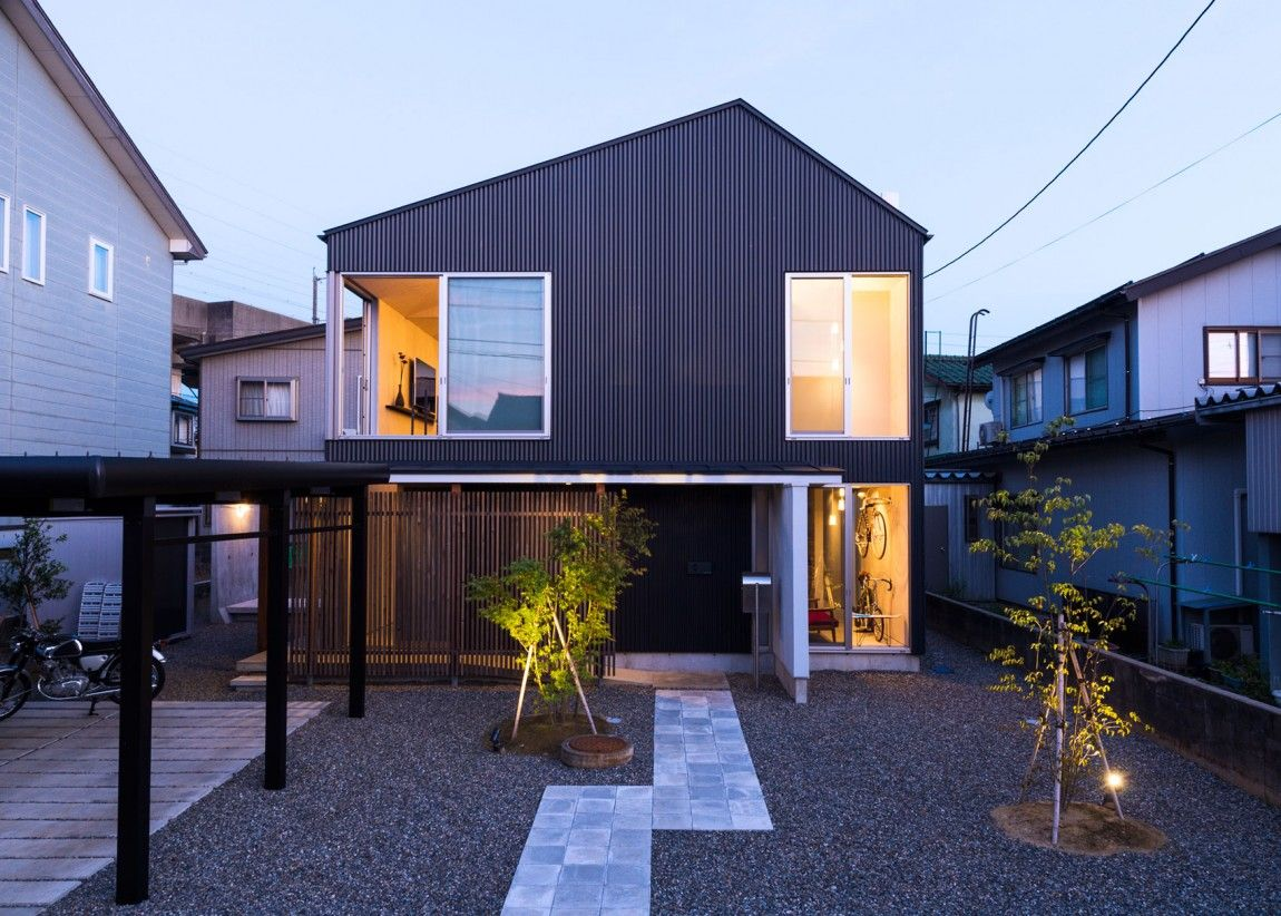 Takeru Shoji Architects Design a Hip Private Home in Nagaoka backyard