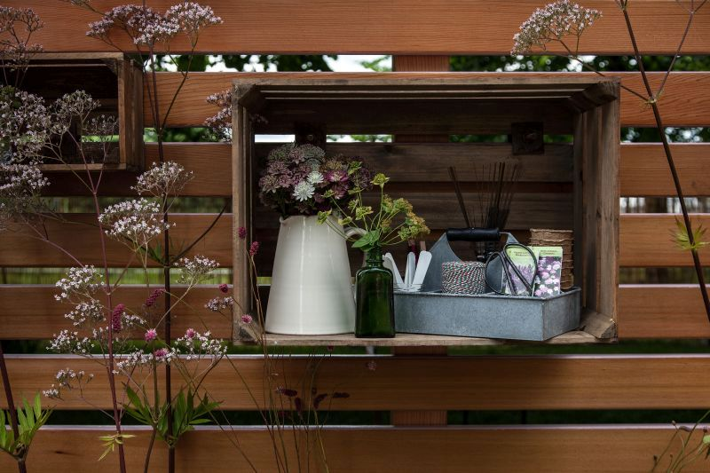 Decorate the backyard fence with crates