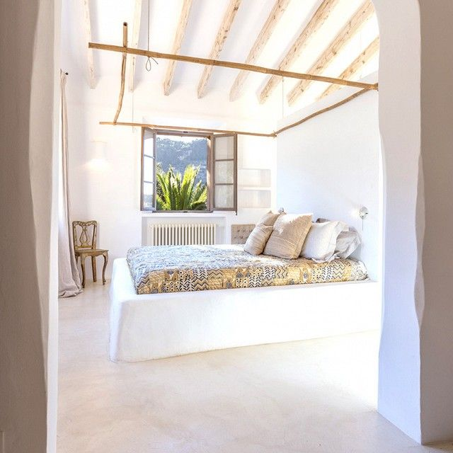 Exposed wooden beams in bedroom