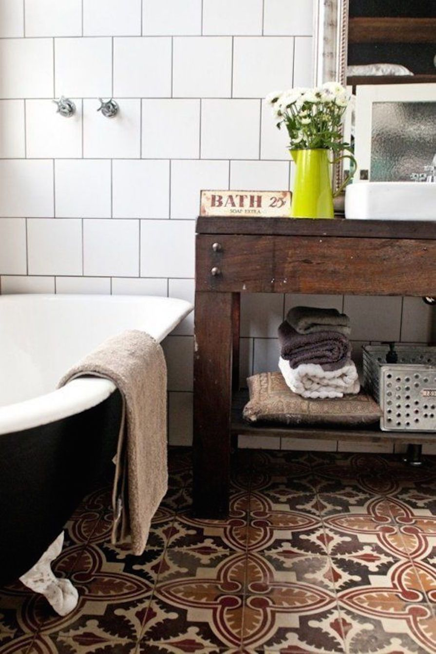 Freestanding tubs and patterned floor tiles