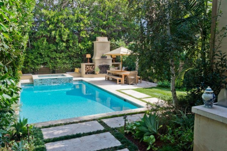 Large pool and fireplace next to