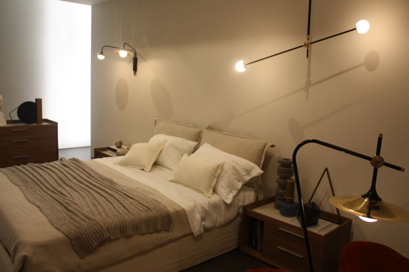 Modern wall lights above the bed - cream bed