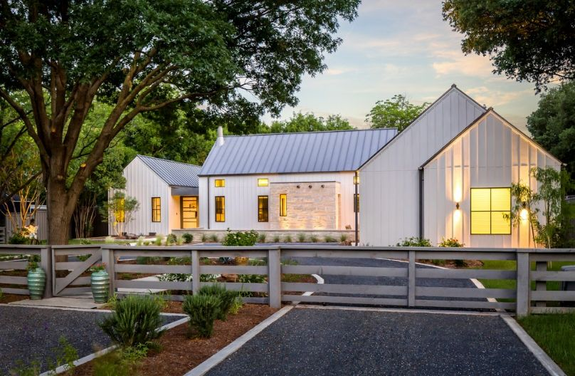 Old barn house with a modern gravel driveway