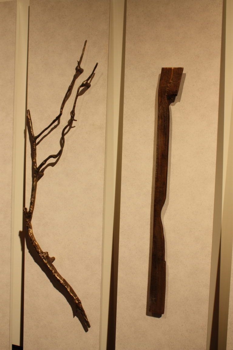 The large Branch door handle is truly a work of art. It is made of aluminum that is hand-cast from a real tree branch. On the right is his Plank handle, which looks like natural piece of wood.