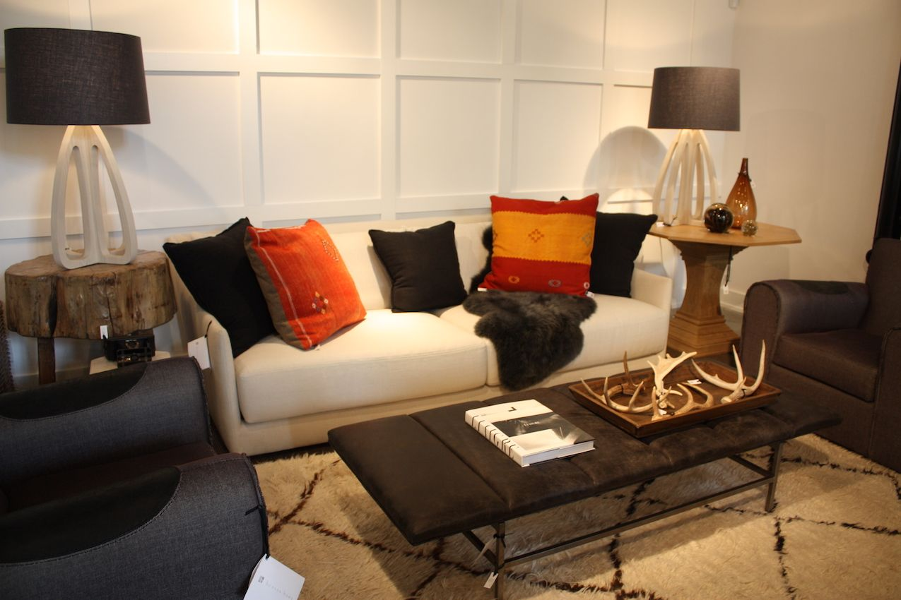 This versatile grouping (which includes the previously shown chairs) is elevated with the careful selection of accessories. A pop of color from the pillows and interesting lamp shapes bring a neutral palette from blah to beautiful. The paragon of two different side tables is also a smart move to keep the grouping from looking too matchy-matchy.