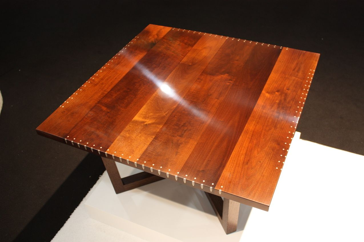 Square coffee table with bullet casing edge design.