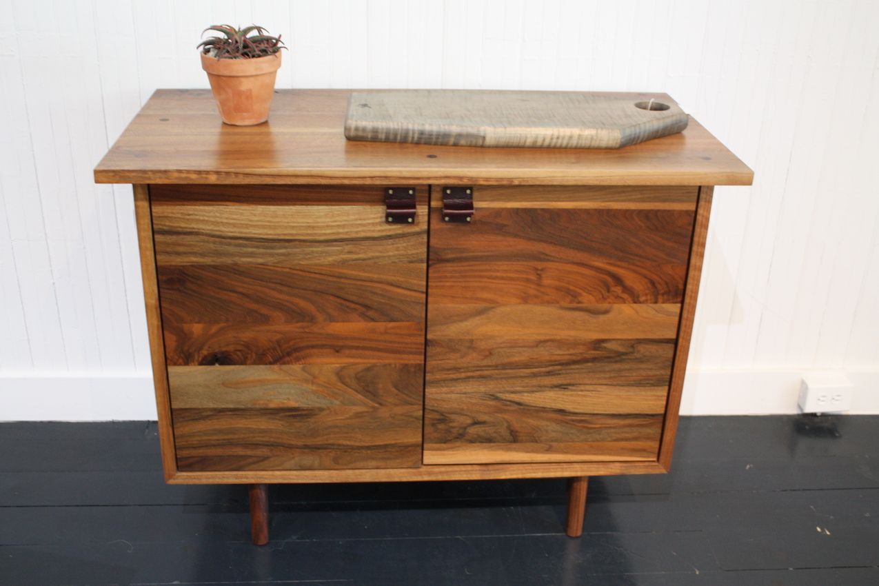 This is the Spring Bureau, which you can have with leather or turned hardwood pulls, and a walnut interior.