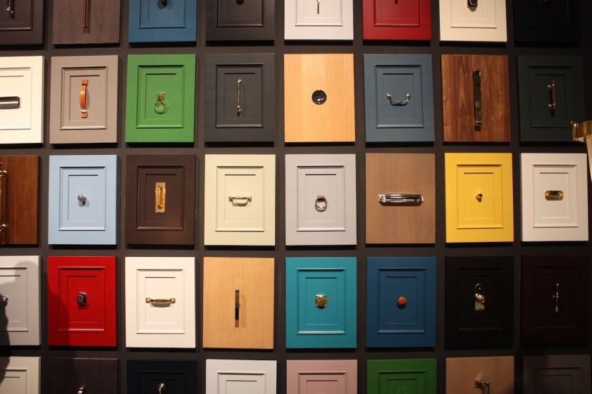 A wall of rainbow cabinet faces is an impressive way to display Waterworks's decorative hardware options.