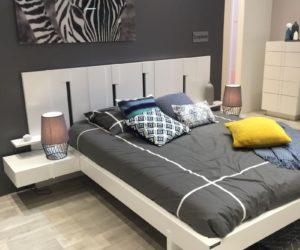 White framed bed and zebra canvas print
