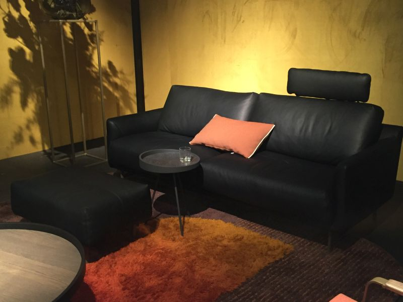 Black leather couch with a small round table