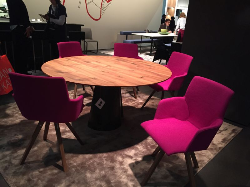 Round dining table with bold chairs