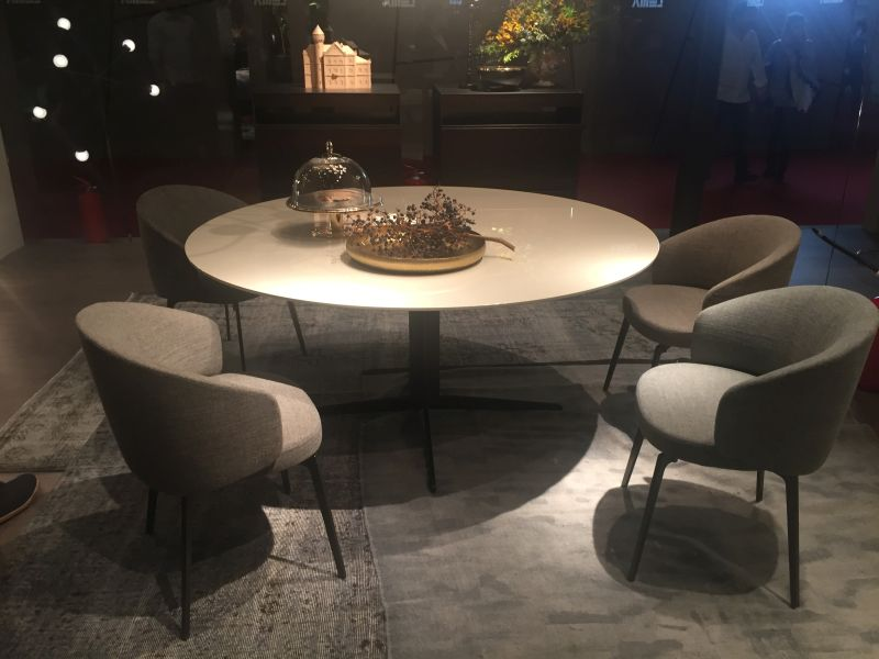 Simple round dining table with cool armchairs