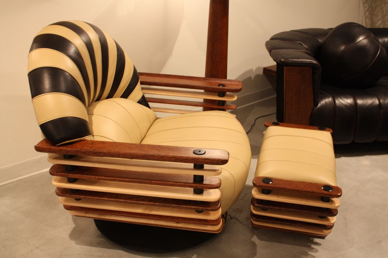 Striped leather and tiered wood for the frame make this very unusual armchair.