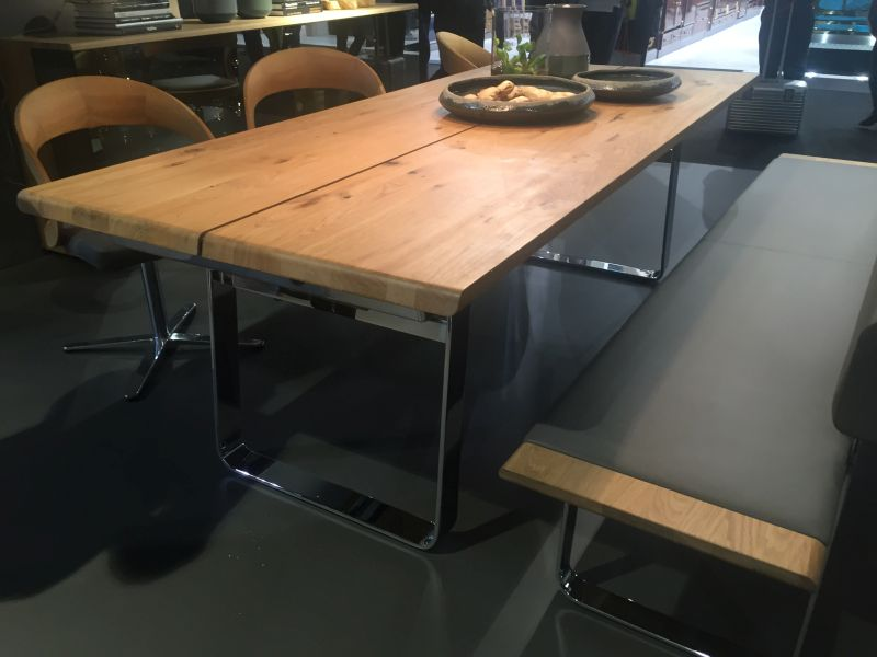wood dining table with bench setting and swivel chairs - all with chrome base