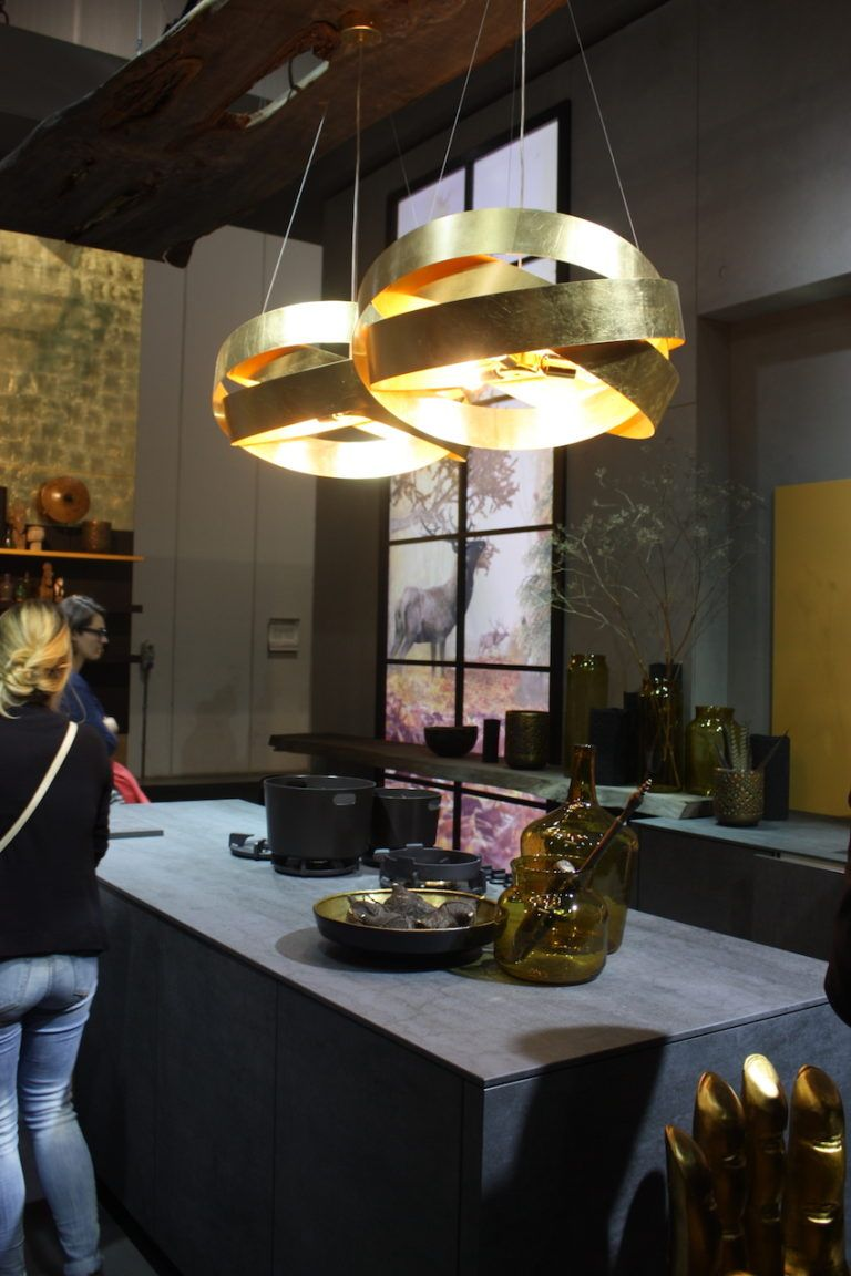 A pair of gilded modern pendants adds a little bling to Alno's otherwise industrial design.