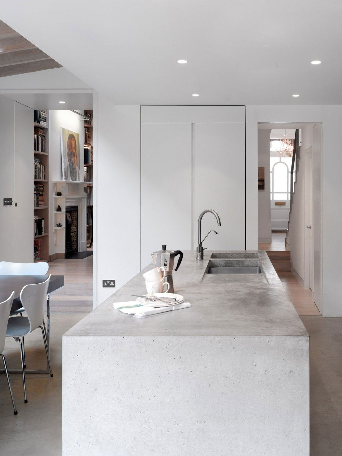 Book tower house concrete kitchen design