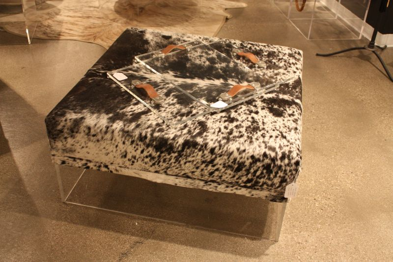 Cowhide ottoman with acrylic base
