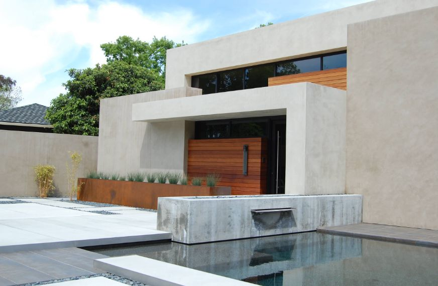 Geometrical modern house with corten large planter
