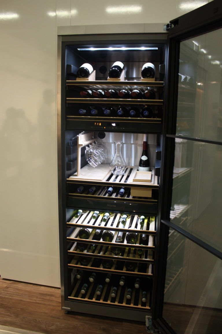 Miele's sophisticated wine tower includes serving space.