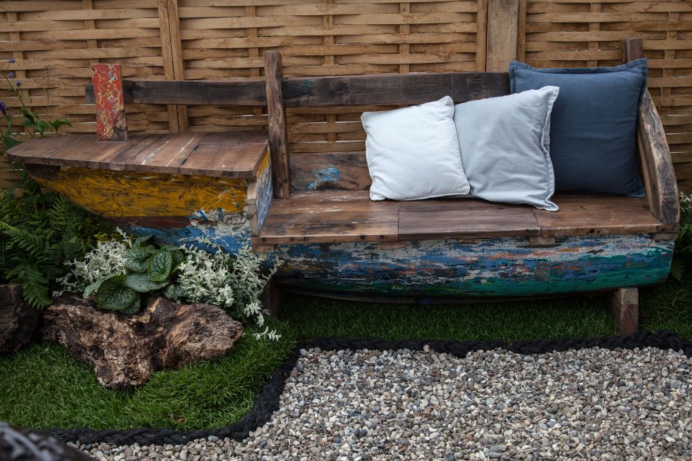 Recycle an old canoe and turn into a bench