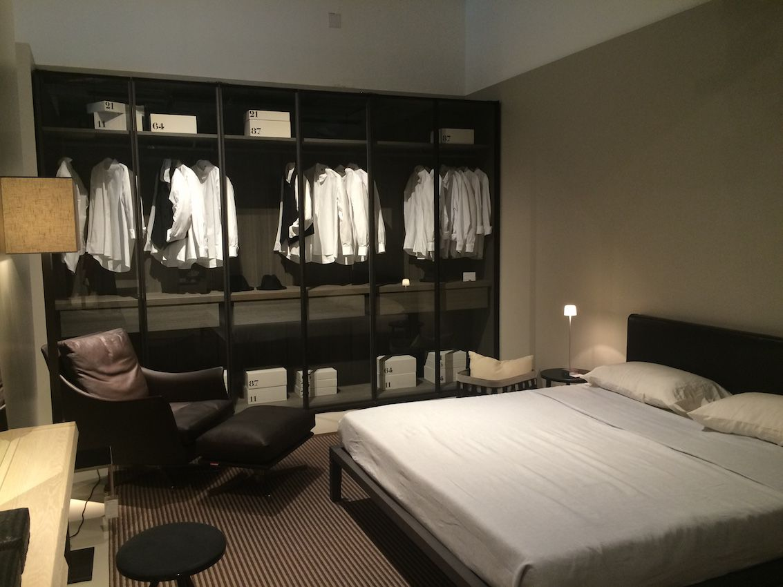 Bedroom with a large transtparent wardrobe