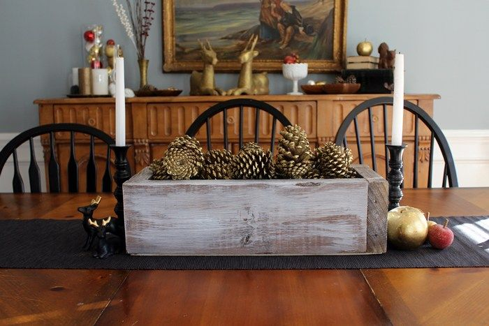 Wooden box with pinecones