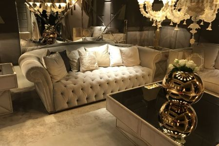 Details Make the Difference in Baroque  Rococo Style Furniture The muted colors  chandelier style and gilded accents of this more modern  living room hearken back to Rococo