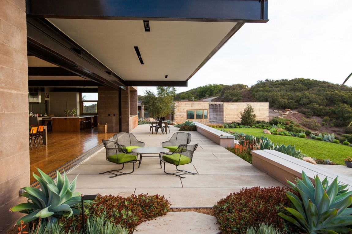 Cool Concrete Patio Designs And The Houses They Complement View in gallery