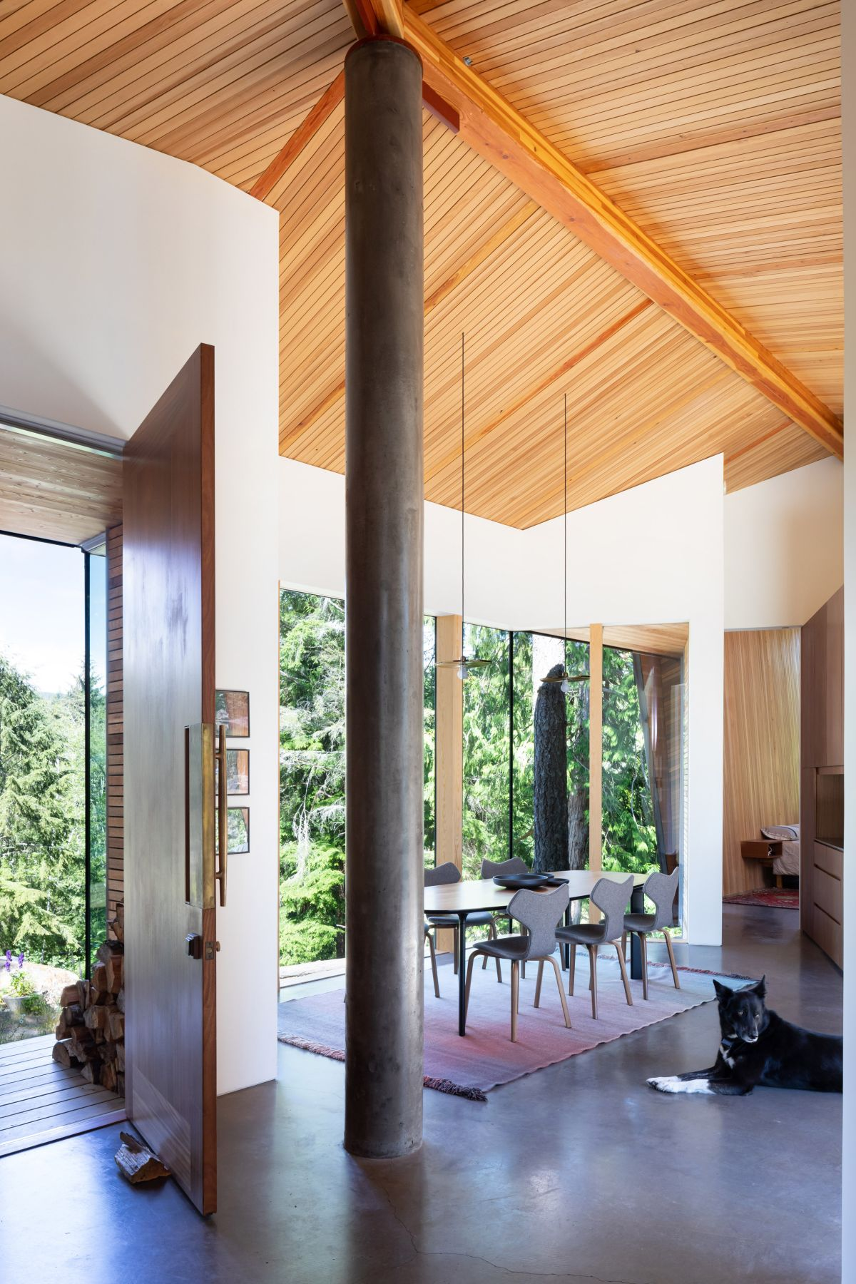 A large blackened steel column runs through the living area and mimics a tree trunk