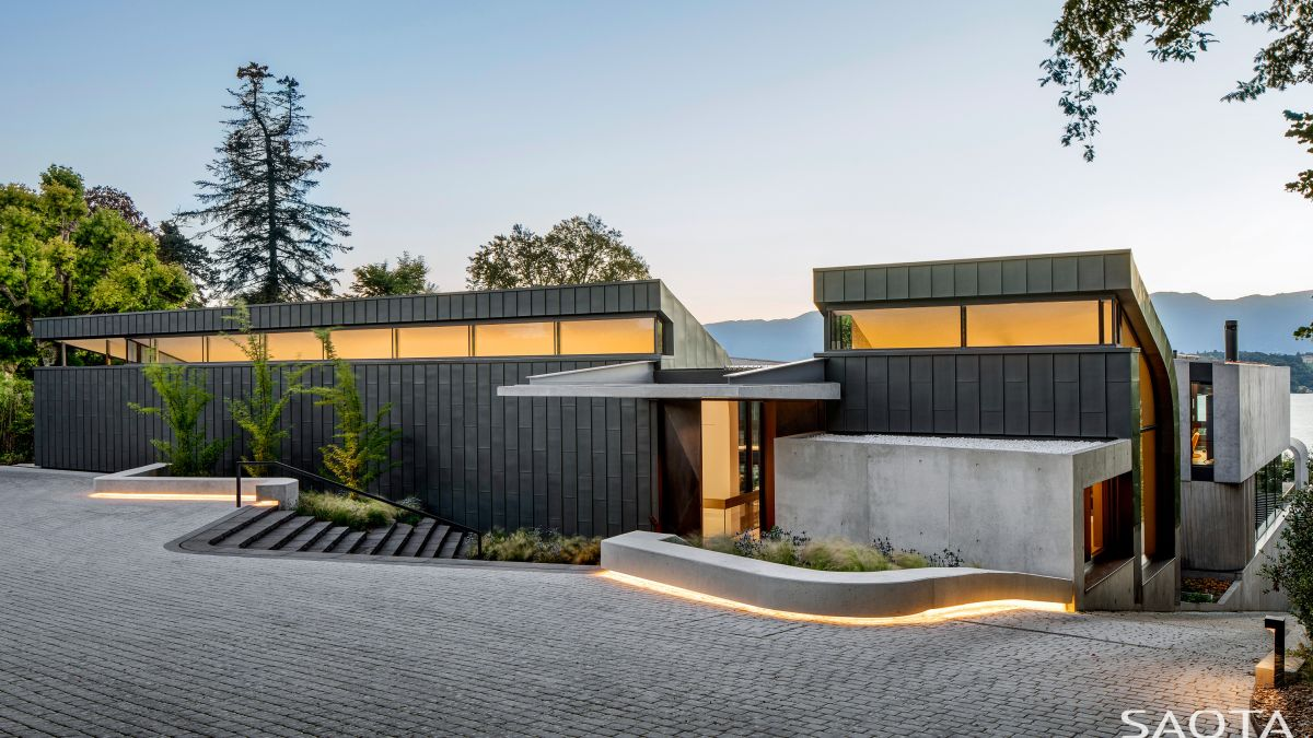 The front section of the house is quite different than the rest, being mostly opaque and clad in zinc panels