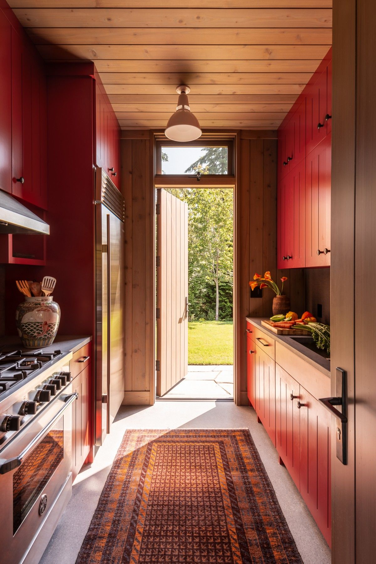 The kitchen has direct access outdoors through a wooden back door