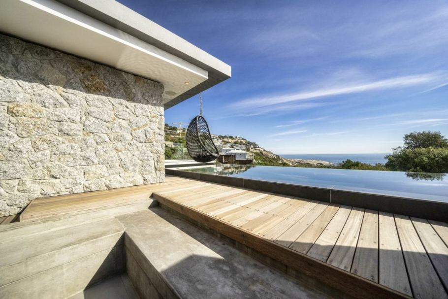 The swimming pool and deck are facing the ocean and maximize the beautiful view