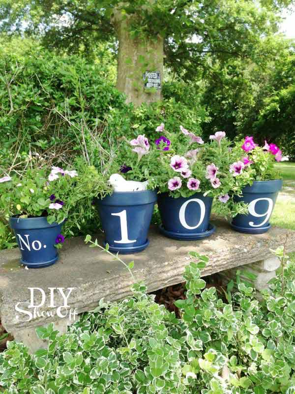 26 Beautiful Simple and Inexpensive Garden Projects Realized With Clay Pots homesthetics decor ideas (3)