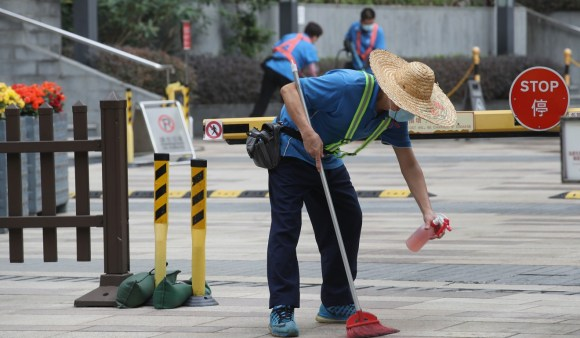 Workers disinfect Oceanaire residence in Ma On Shan, where a person thought to be infected with the Wuhan coronavirus lives. Photo: Winson Wong