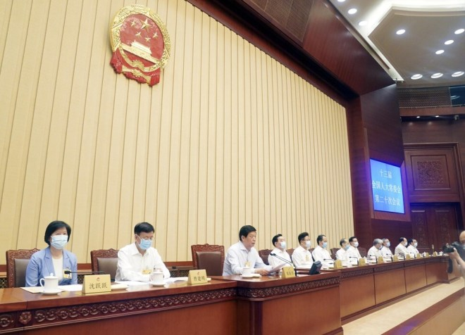 Li Zhanshu, chairman of the National People's Congress Standing Committee, presides over the meeting on Tuesday. Photo: Xinhua