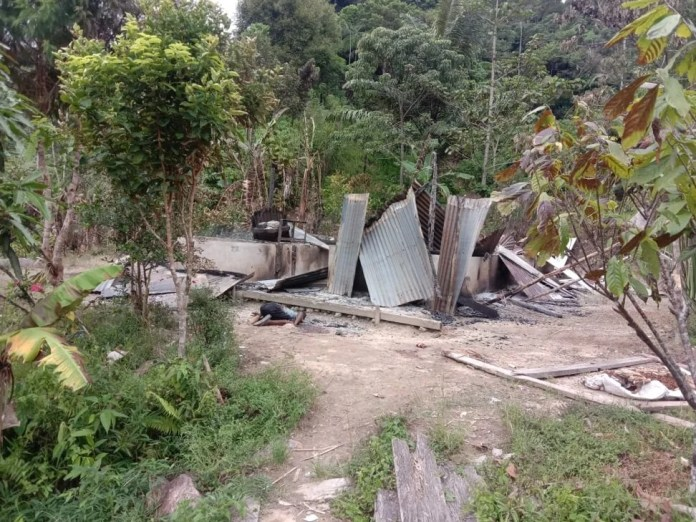 Burnt homes in a remote village in Sigi regency, Central Sulawesi, seen on Saturday. Photo: Handout