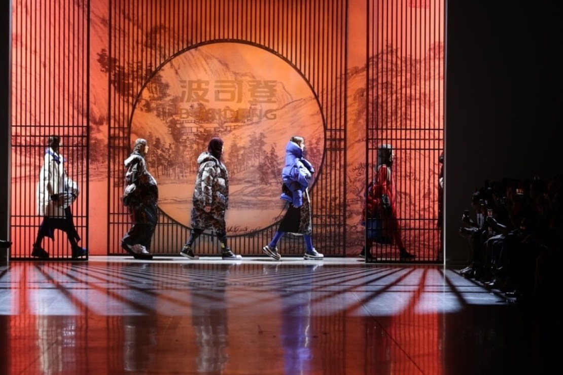 A show by Chinese fashion brand Bosideng at New York Fashion Week. Originally a supplier of down jackets to international brands, Bosideng is one of a number of high street Chinese fashion labels looking to expand in Western markets. Photo: PRNewsfoto/Bosideng