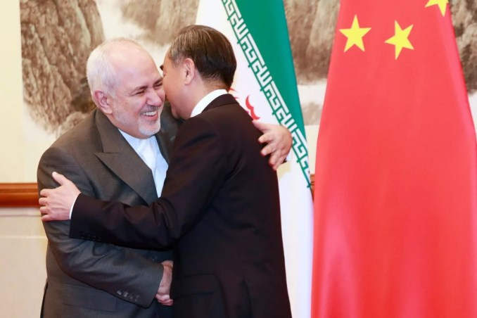 Iranian Foreign Minister Mohammad Javad Zarif meets his Chinese counterpart Wang Yi in Beijing on Monday. Photo: AFP