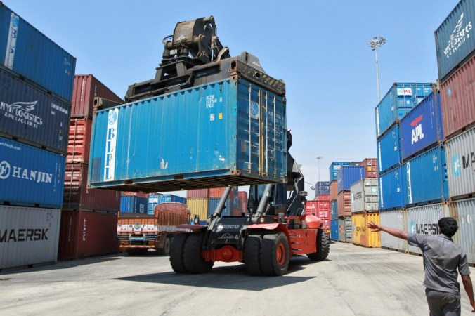 A mobile crane prepares to stack a container at a port in the southern Indian city of Chennai. Photo: Reuters