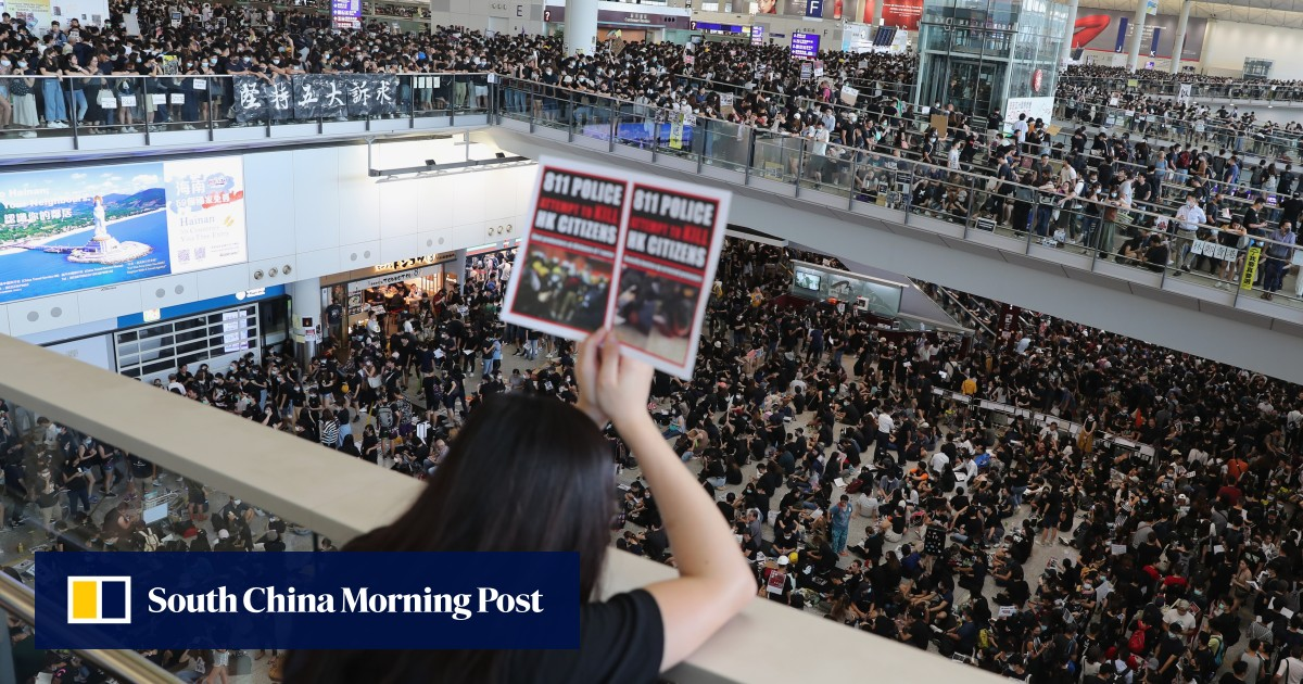 Protest cripples airport as Beijing raises stakes with 'terrorism' warning