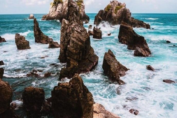 Image result for Pekatnya warna biru air laut Pantai Gigi Hiu dijamin memanjakan mata