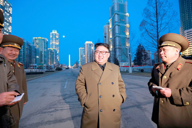 Kim Jong-un talks to military officials in Pyongyang