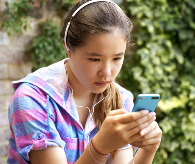 Girl hunched over phone
