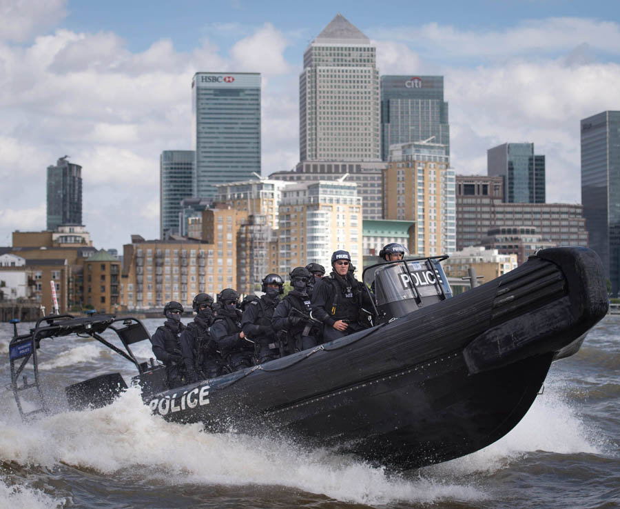 Armed Metropolitan Police counter terrorism officers take part in an exercise on the River Thames in London