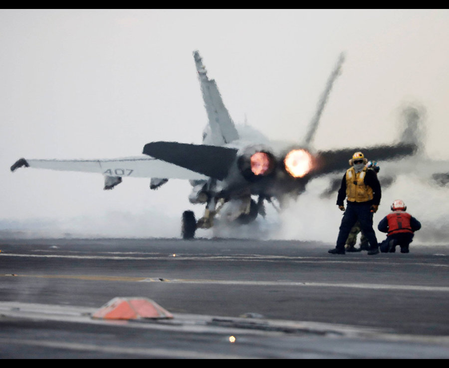 An F18 fighter jet takes off from the deck of US aircraft carrier USS Carl Vinson