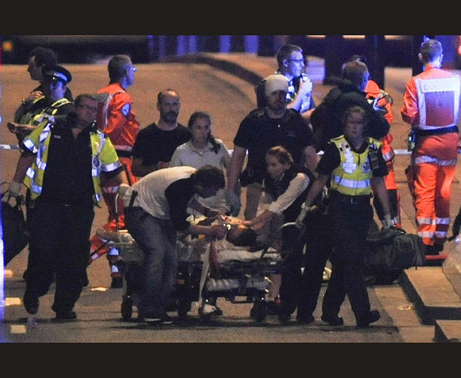 Members of the emergency services attend to victims of a terror attack on London Bridge on June 3rd 2017