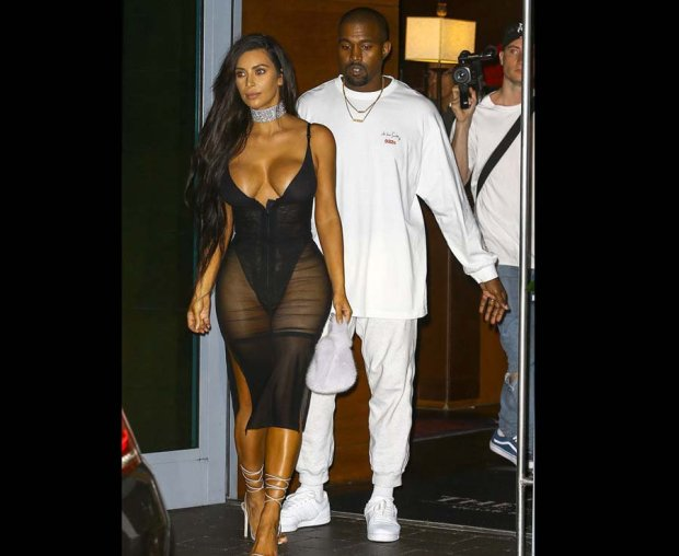 Kim Kardashian is pictured in a sheer dress