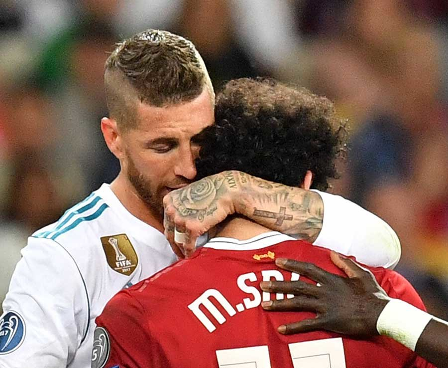 Sergio Ramos of Real Madrid (L) hugs Mohamed Salah